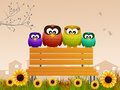 Owls on the bench family of Royalty Free Stock Images
