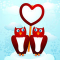 Owls with heart Stock Photos