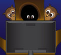 Owls watching tv family of in a tree a scary show on Royalty Free Stock Photos