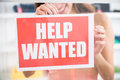 Owner Holding Help Wanted Sign In Retail Store Royalty Free Stock Photo