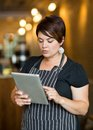 Owner using digital tablet in cafe beautiful female coffee shop Stock Image