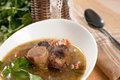Ox tail soup barley parsley close up Stock Photography