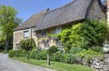 Oxfordshire thatched cottage with pretty garden kingham england Royalty Free Stock Photography
