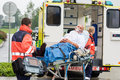 Oxygen mask patient treatment ambulance stretcher Royalty Free Stock Photo