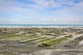 Oyster parks cancale in france at low tide Stock Photos