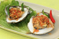 Oyster with spicy sauce two opened oysters thai garlic and chili on the plate selective focus Royalty Free Stock Photography