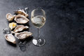 Oysters with lemon and white wine Royalty Free Stock Photo