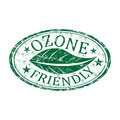 Ozone friendly grunge rubber stamp green with a leaf and the text written inside the Royalty Free Stock Images
