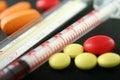 Píldoras, jeringuilla y termómetro Imagenes de archivo