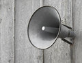 PA Speaker on wooden wall. Royalty Free Stock Photo