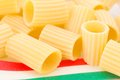 Paccheri typical italian pasta bronze extruder Royalty Free Stock Photos