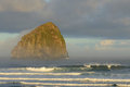 Pacific city haystack rock chief kiawanda in the sunrise morning light at oregon with mild pacifci ocean surf Royalty Free Stock Images