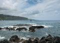 Pacific ocean breaks against lava rocks at Keanae Royalty Free Stock Photo