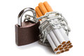 Pack of cigarettes and a padlock with chain. concept stop smoking Royalty Free Stock Photo