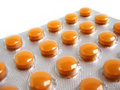 Pack of orange pills Royalty Free Stock Images