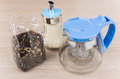 The package of tea glass teapot and sugar bowl on wooden table Royalty Free Stock Photo