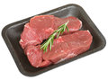 Packaged boneless lamb leg meat steaks raw in styrofoam tray Stock Photography