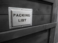 Packed in dark wooden cargo box. The packaging of the goods. Packing list. Special treatment of wooden packing for the tropics. Royalty Free Stock Photo