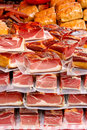 Packed pieces of meat on a market vacuum farmers Stock Images