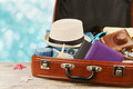 Packed vintage suitcase for summer holidays, vacation, travel and trip. Royalty Free Stock Photo