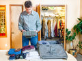 Packing suitcase a man is his for a trip Royalty Free Stock Photos