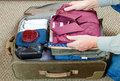 Packing suitcase Royalty Free Stock Photo