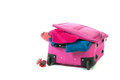 Packing the suitcase pink for summer vacation Stock Photos
