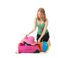 Packing the suitcase by a young woman pink for summer vacation an blond Royalty Free Stock Image