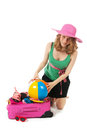 Packing the suitcase by a young woman pink for summer vacation an blond Royalty Free Stock Images