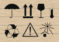 Packing symbols set on wooden background vector illustration Royalty Free Stock Images