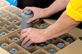 Packing water filters worker hands packaging a into a box Royalty Free Stock Photography