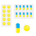 Packing yellow blue and yellow capsule pills  on white background. Royalty Free Stock Photo