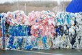 Packs and Stocks of Wrapped Scrap Plastic Dedicated for Eco Recycling in front of a Recycling Factory Royalty Free Stock Photo