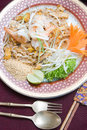 Pad thai served with chopsticks and forks with dish Stock Images
