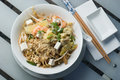 Pad thai served with chopsticks and forks with dish Royalty Free Stock Images