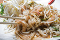 Pad thai served with chopsticks and forks with dish Stock Image