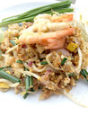 Pad Thai, stir-fried rice noodles with shrimp in white dish on white background. The one of Thailand's national main dish. th Royalty Free Stock Photo
