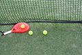 Paddle balls and paddle rackets on a tennis court Royalty Free Stock Images
