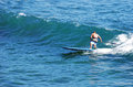 Standup paddle boarder surfing off Heisler Park, Laguna Beach, California. Royalty Free Stock Photo