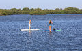 Paddle boarding lesson attractive female receives a in how to board near singer island florida Stock Photography
