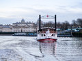 Paddle steamer elizabethan on the thames at greenw of luxury charters tlc steams toward viewer with winter afternoon greenwich Royalty Free Stock Photo