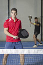 Paddle tennis match two brunette young adults playing Royalty Free Stock Image