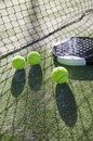 Paddle tennis still life objects on artificial turf ready for tournament with hard dramatic shadows Royalty Free Stock Photos