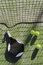 Paddle tennis still life objects on artificial turf ready for tournament with hard dramatic shadows Stock Photos