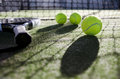 Paddle tennis still life objects ion artificial turf ready for tournament with hard dramatic shadows Royalty Free Stock Images
