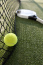 Paddle tennis still life objects on turf near to net Stock Photography