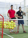 Paddle tennis team training basket with pupils blured in background Stock Photography