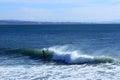Paddleboarder Rides The Wave I...