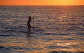 Paddleboarder at Woods Cove Beach in Laguna Beach, California. Royalty Free Stock Photo
