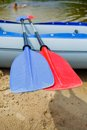 Paddles for white water rafting red and blue and kayaking Royalty Free Stock Photo